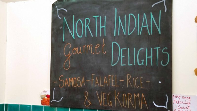 North Indian Gourmet Delights Sign