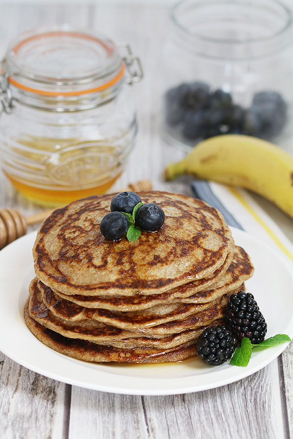 rye sourdough pancakes with maple syrup and blue berries