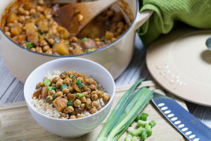 chickpea and potato curry with bowl of rice