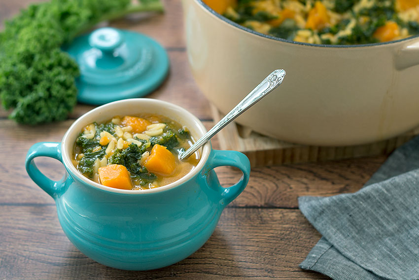 Vegan Kale and Pumpkin soup with Orzo with spoon