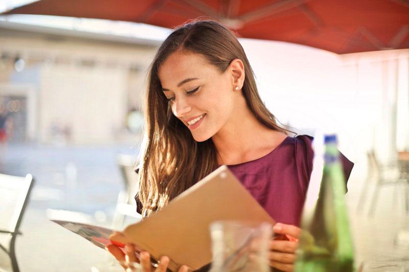 woman reading gluten-free menu