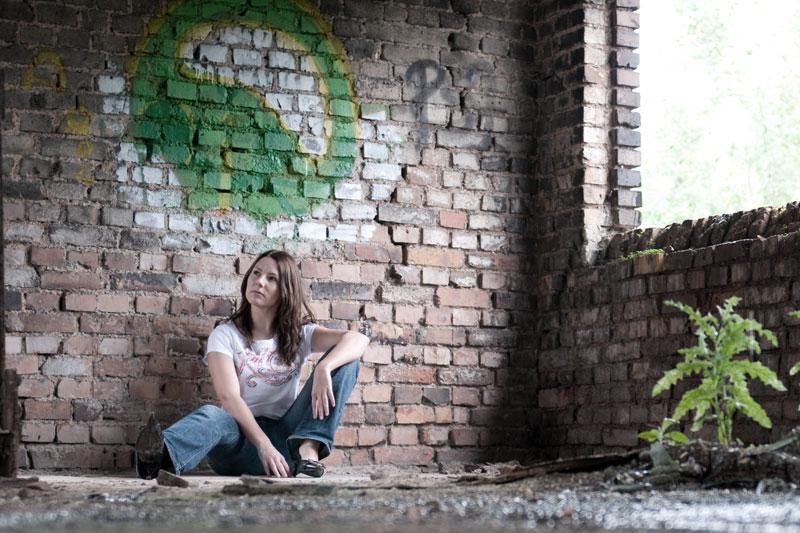 Eva Burg beside the window